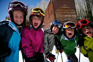 Kids doing winter sports yelling with regular protection and UV protection on
