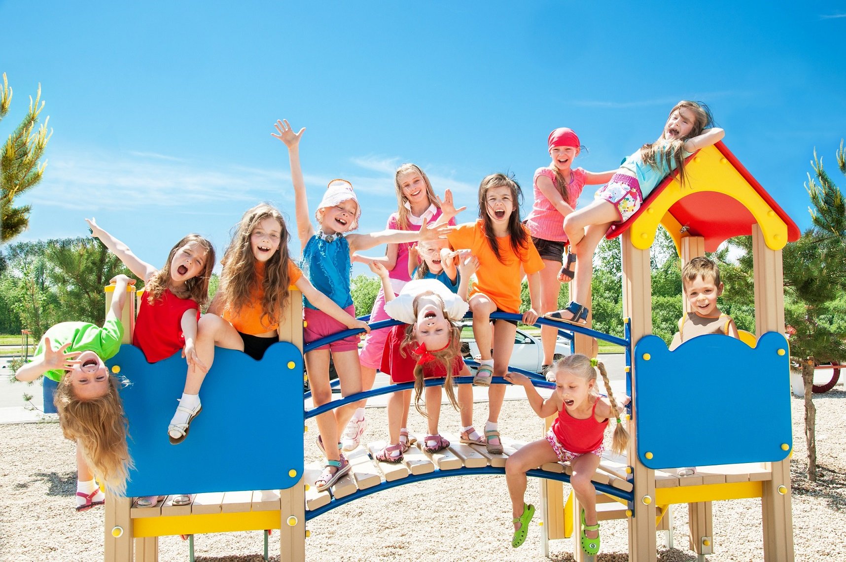 Image of happy kids playing on playground