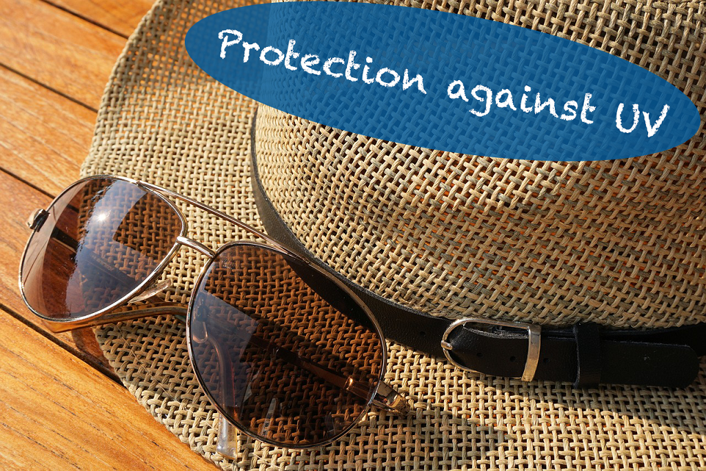 Sunglasses and hat for protection against UV rays.