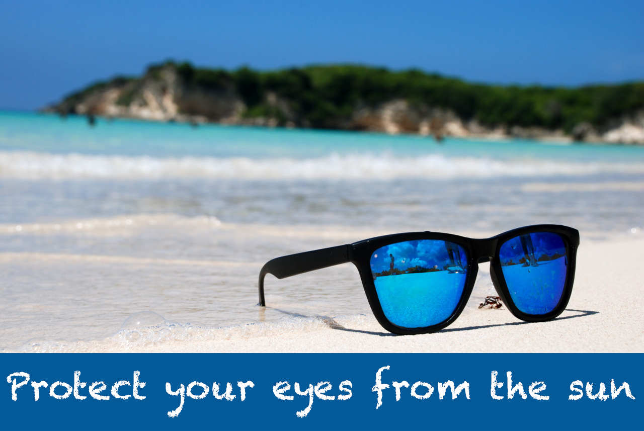 Sunglasses on a beach. Protect yourself against UV rays.